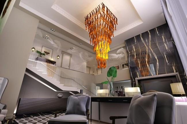 Проект таунхауса в Москве после ремонта и декора в современном стиле: многоярусная люстра в гостиной, вид со второго этажа