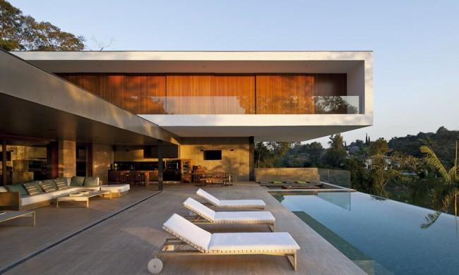 Стильный дом с бассейном в стиле модерн