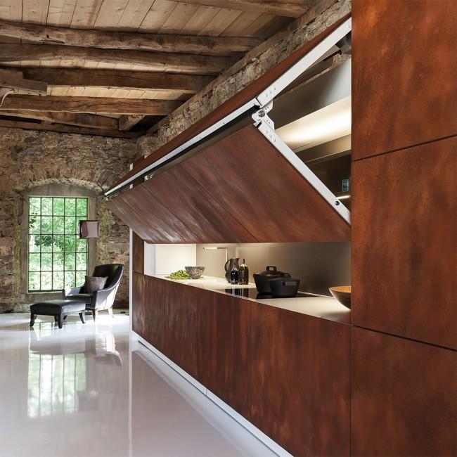 Кухонный гарнитур, находящийся под одну стену подойдет для просторной кухни либо квадратной, тем самым удлинив её