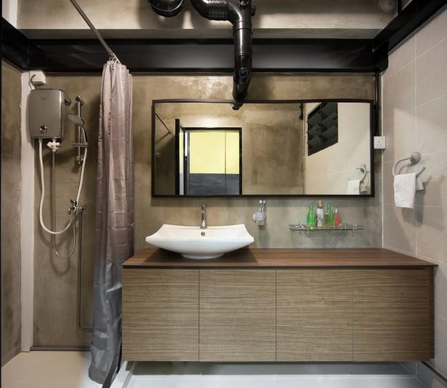 """Бетонные поверхности, разнообразные аксессуары ярких """"сигнальных"""" цветов, всевозможные цепи, опоры и швеллеры (совершенно необязательно функциональные) создадут стиль лофт в ванной комнате любого размера. Конечно, желательно, чтобы этот стиль органично продолжал единый стиль всего жилища"""