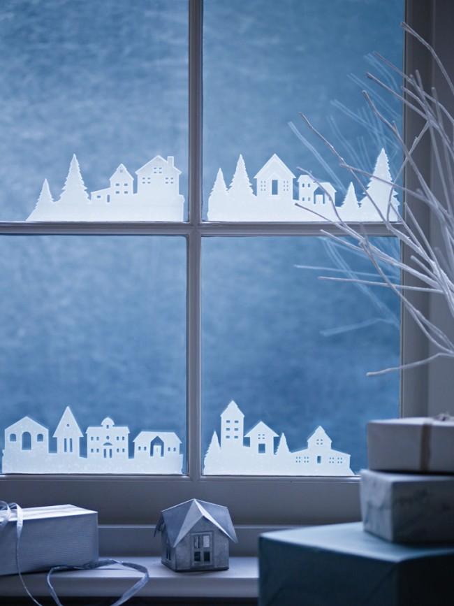 Никогда не устаревает идея снежного зимнего декора из бумаги на оконных стеклах