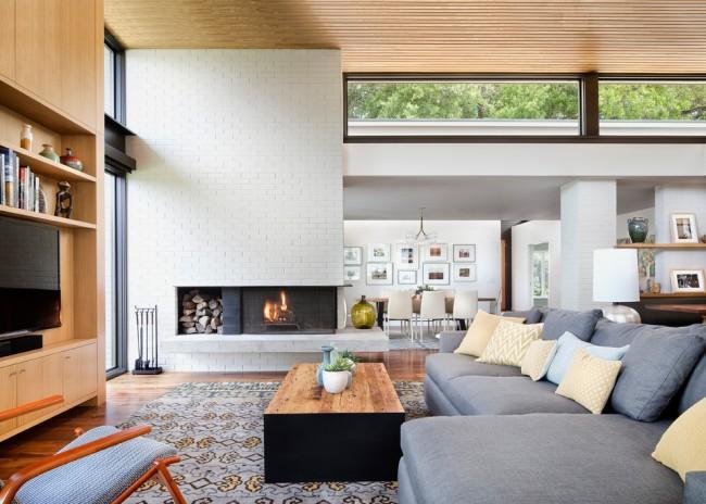 Удачное сочетание дизайна камина и интерьера гостиной в стиле модерн