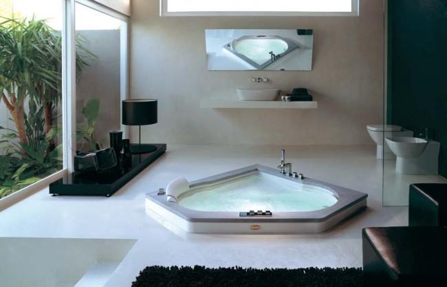Современная угловая ванна отлично впишется в стиль хай-тек