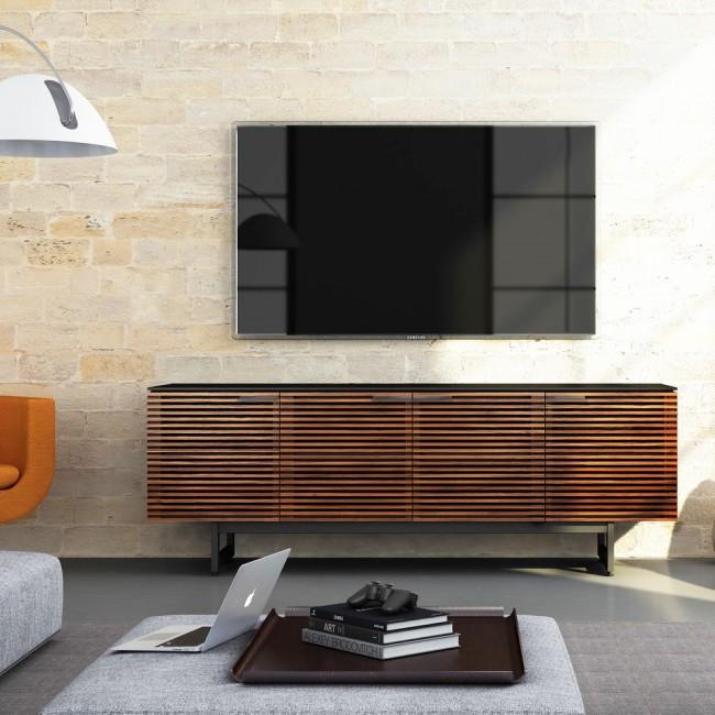 Несмотря на то, что многие модели современных телевизоров крепят на стене, так как они очень тонкие, тумбы под телевизор все равно остаются востребованными