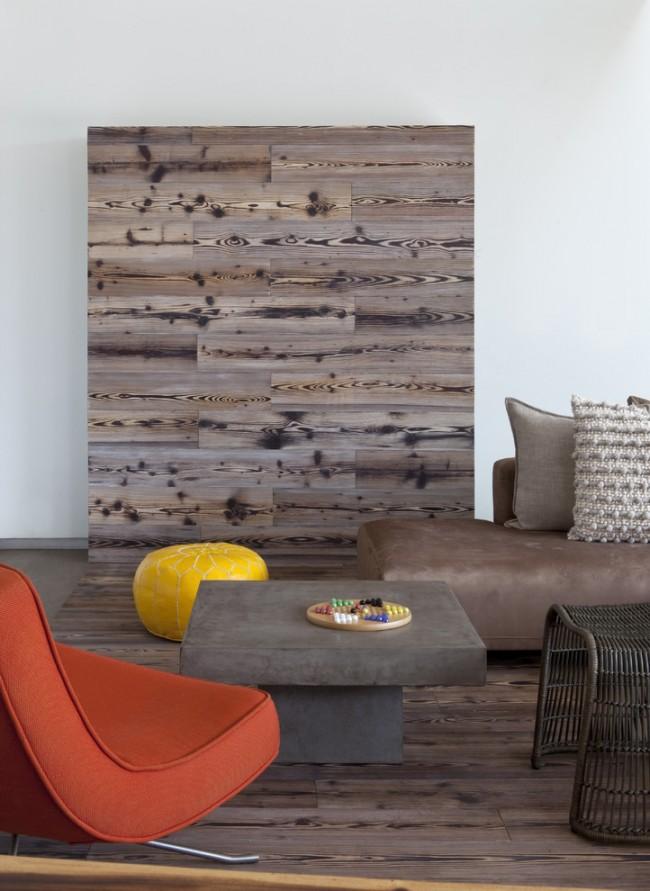 С помощью ламината можно зонировать просторную комнату. создавая акцент на стене