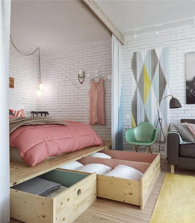 Однокомнатная квартира в стиле лофт, где подиум из нарочито грубо обработанной древесины вписан в просторную нишу