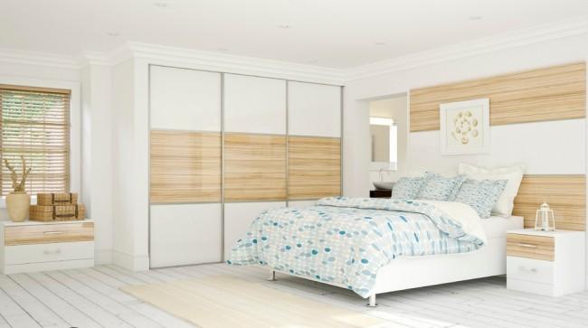 Материалы наружной отделки шкафа повторяют остальную отделку в спальне