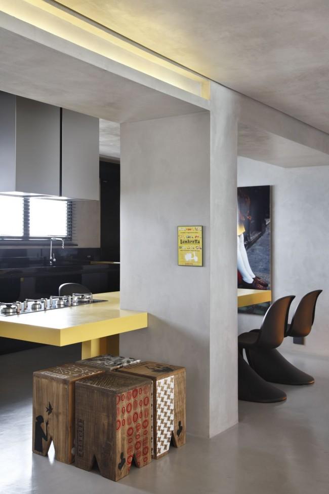 Полированный бетон и мягкий приглушенный желтый цвет столешницы из искусственного камня