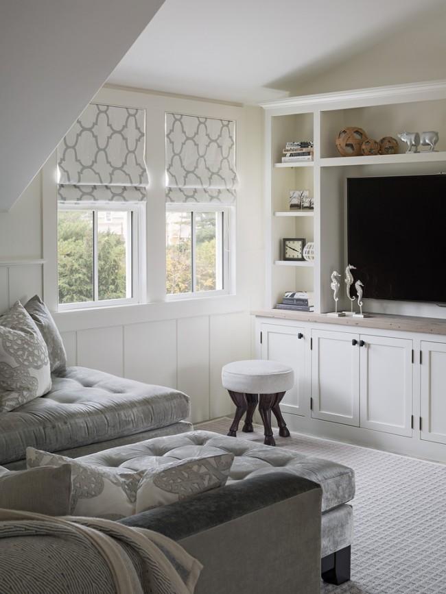 Минимальное количество предметов мебели и светлые тона визуально увеличат даже самую маленькую гостиную
