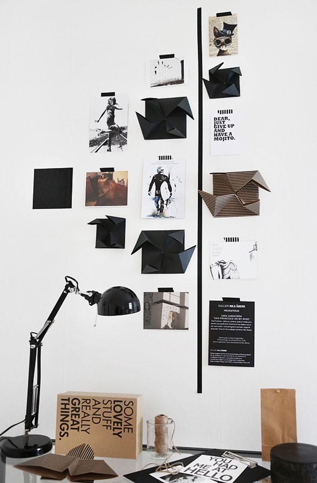 Оригинальные элементы из скрап-бумаги в технике оригами разнообразят пустую стену над письменным столом