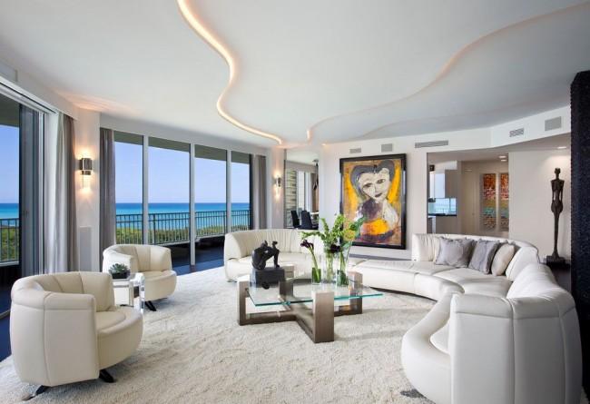 Оригинальные контуры и изгибы гипсокартонной конструкции - идеальный выбор для гостиной в стиле модернизм с нестандартной планировкой