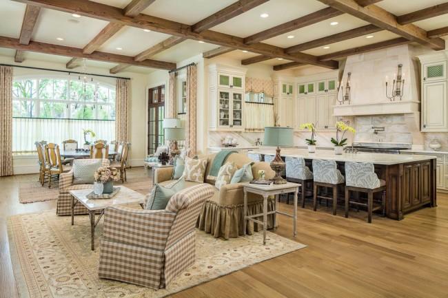 Бежевые тона в дизайне гостиной, совмещенной с кухней, прекрасно подчеркнут французский кантри