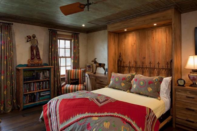 Кованая кровать в интерьере спальни африканского стиля