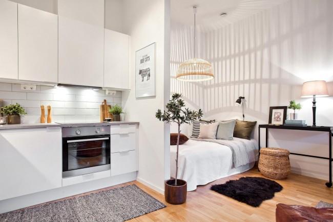 Гипсокартоновые перегородки отлично справятся с зонированием квартиры-студии