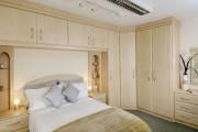 Фото 8 Угловой шкаф в спальню: обзор современных моделей в интерьере и рекомендации по выбору