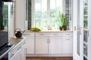 Фото 16 Как выбрать плитку на кухонный пол: обзор лучших интерьерных решений и советы специалистов