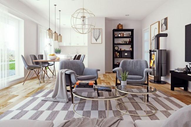 Общая холодная цветовая гамма гостиной выглядит уютно за счет обилия освещения, текстиля и элементов декора