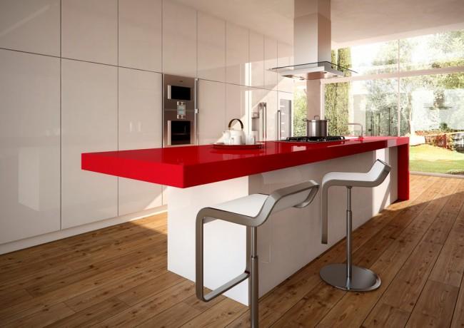 Минималистичный, лаконичный интерьер белой кухни с ярким акцентом - столешницей острова из ярко-красного искусственного камня