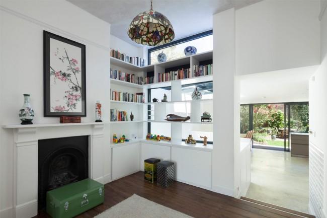 Угловые стенки для гостиной могут служить как для хранения книг, так и для размещения на полках разнообразных мелочей