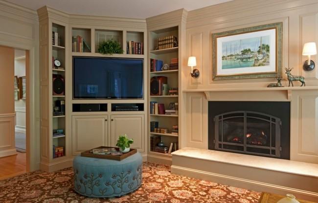 Угловая стенка со встроенным телевизором и прочей техникой, выдержанная в общем стиле и цветовой гамме гостиной