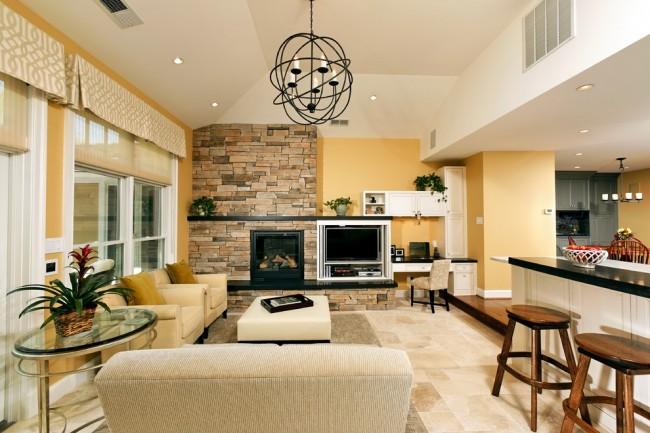 Очень теплая гостиная с необычной модульной стенкой и оригинальной кирпичной кладкой в тон общему цветовому решению
