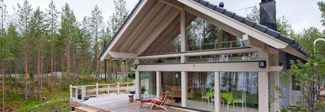 Дом из клееного бруса с террасой в стиле шале