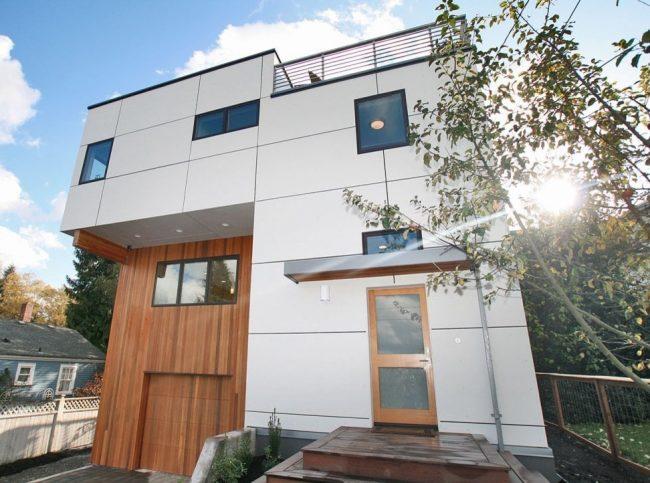 Двухэтажный частный дом с плоской крышей