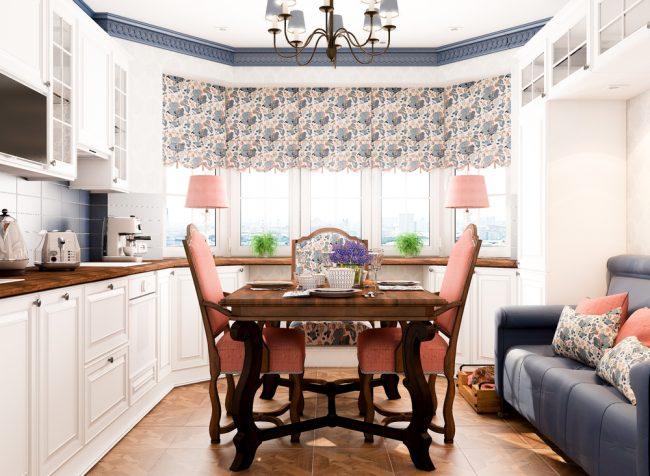 Светлая кухня в стиле кантри с эркером и короткими цветочными занавесками