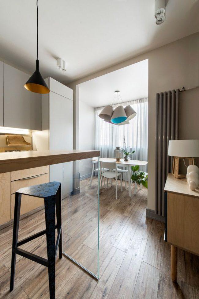 Современный стиль в оформлении кухни и зоны столовой на балконе