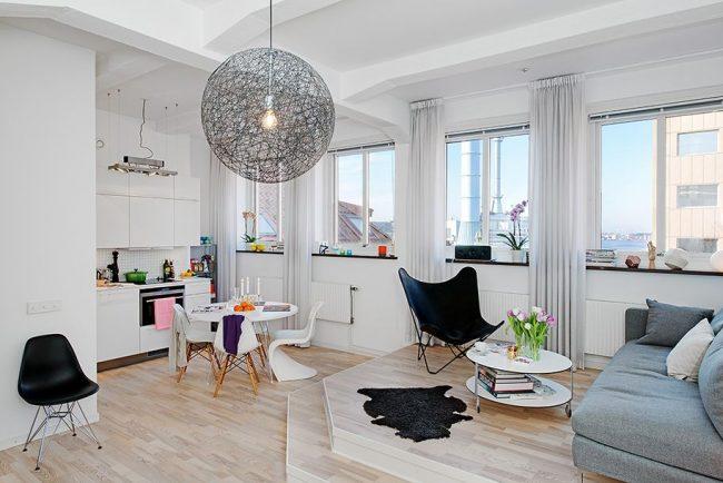 Дизайн однокомнатной квартиры с объединенной кухней в стиле модерн