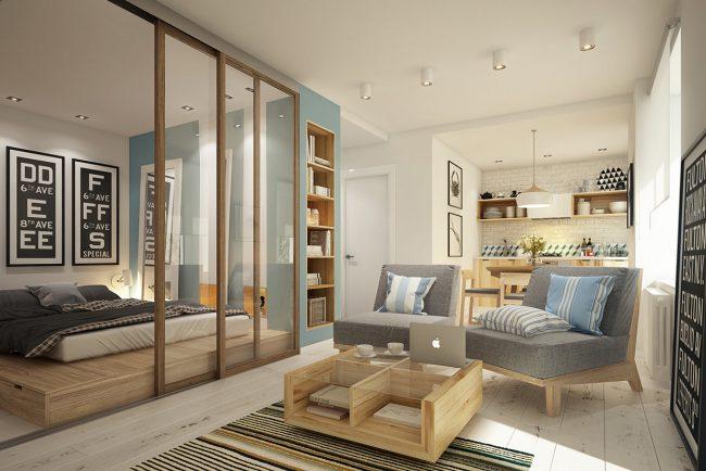 Зона гостиной отделена от зоны спальни прозрачными сдвижными перегородками