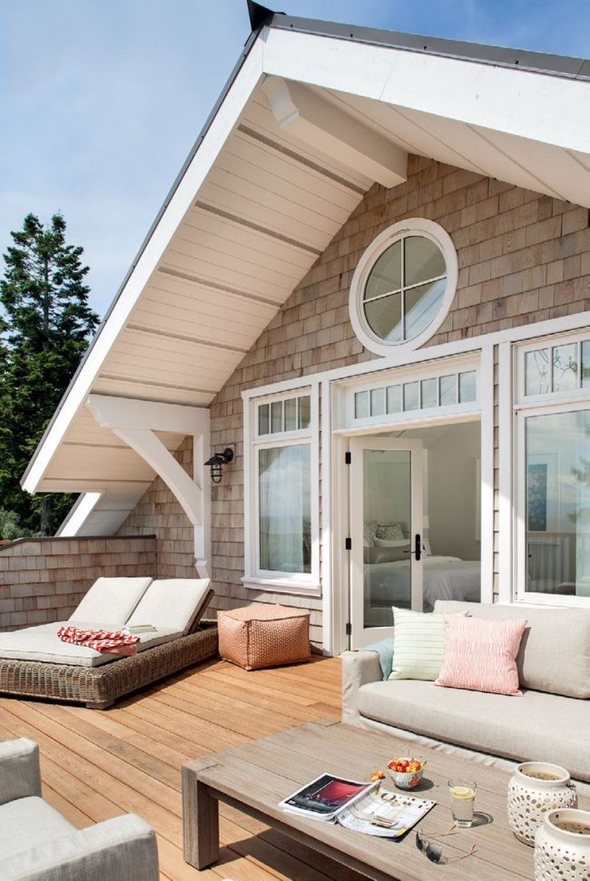 Дом из пеноблоков с открытой летней мансардой