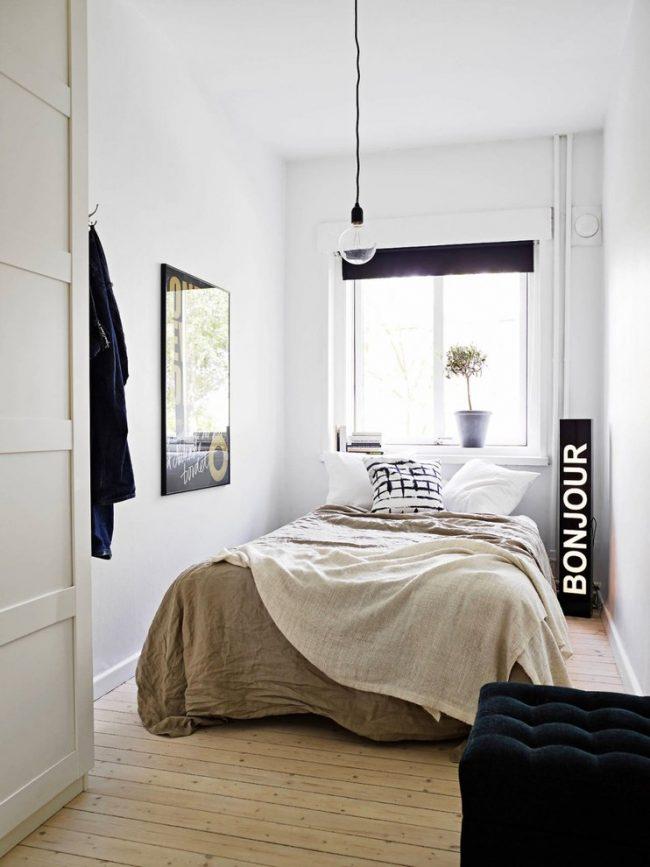 Современный интерьер небольшой спальни в скандинавском стиле