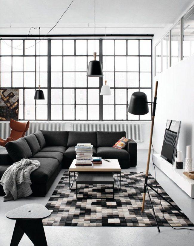 какие батареи отопления лучше для квартиры: гостиная в стиле модерн с большими окнами и белыми радиаторами