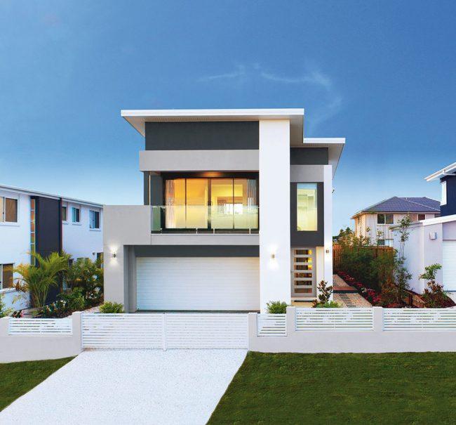 Черно-белый двухэтажный дом с гаражом на две машины