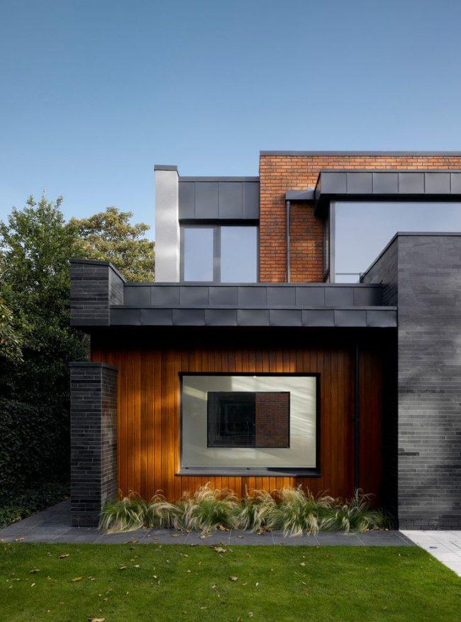 Каркасный дом с комбинированной обшивкой