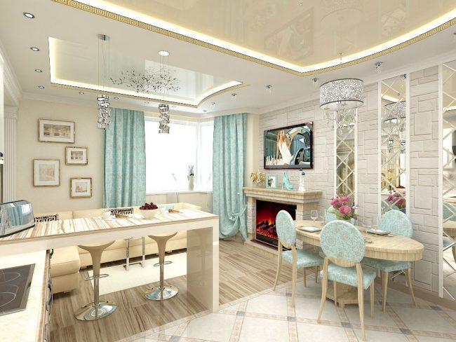Кухня-гостинная в светлых тонах с камином, телевизором, барной стойкой и обеденной группой