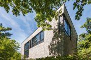 Фото 18 Проекты домов из пеноблоков с гаражом: специфика конструкций и 60+ готовых комфортабельных вариантов