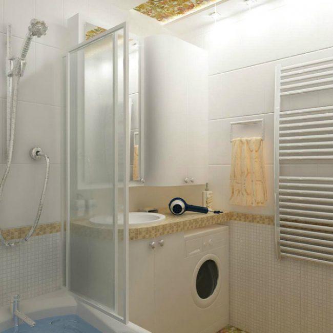 Маленький уголок в ванной комнате под стиральную машину и небольшую раковину, встроенную в столешницу