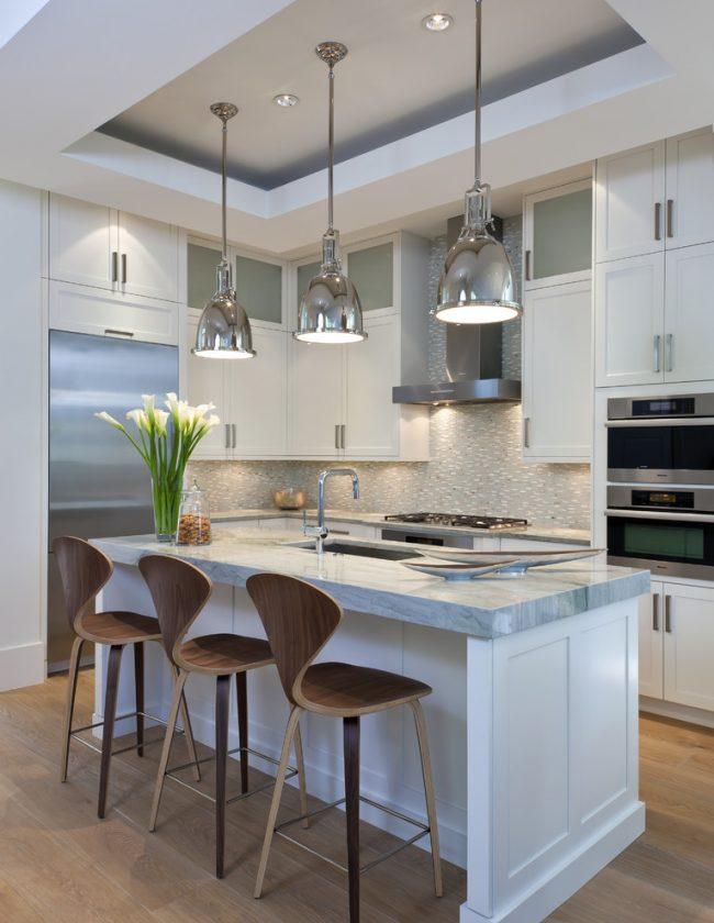 Чтобы хозяйка могла одновременно мыть посуду в двух мойках, вам поможет смеситель с длинным изливом