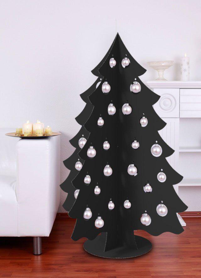 Черная картонная новогодняя елка с белыми шарами