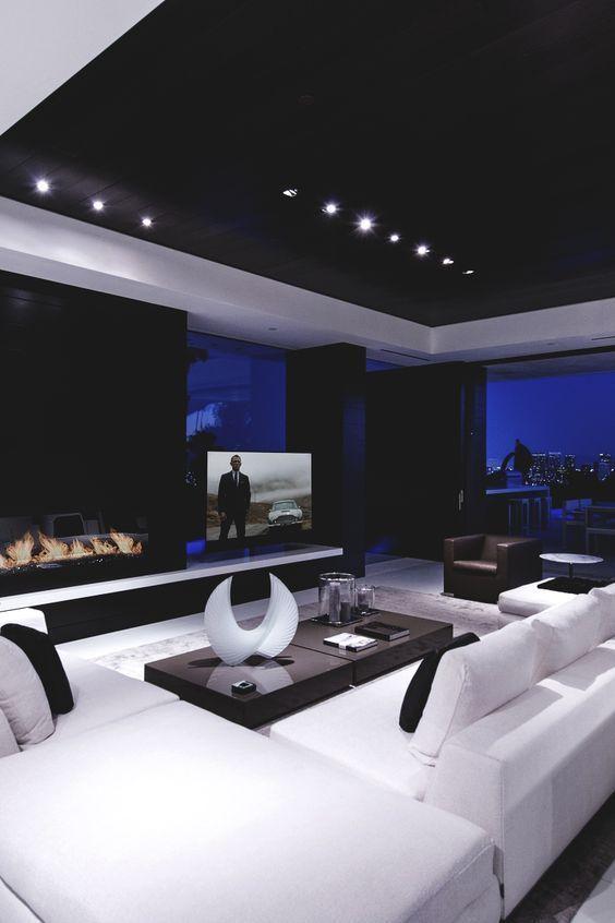 Черный навесной потолок в отделке гостиной в стиле минимализма