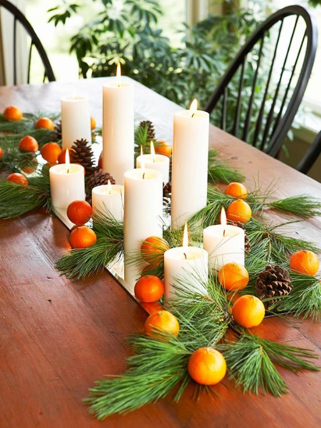Нежная композиция из мандаринов и сосновых веток с шишками