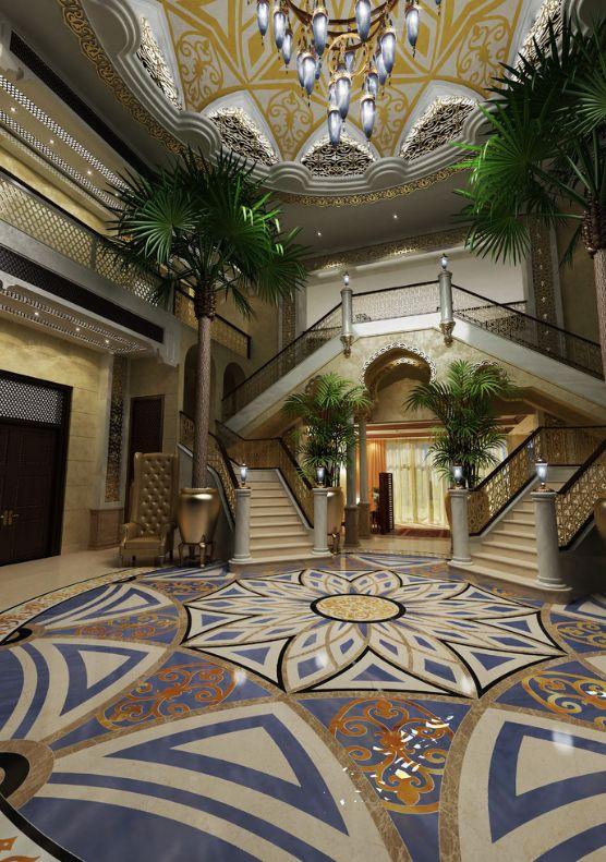 Холл в доме в стиле махараджей: огромные пальмы, высокий куполообразный потолок, лестница и цветочные мотивы на потолке и полу
