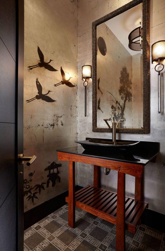 Поверхность стен оклеенную обоями под бетон также можно дополнить небольшими рисунками в стиле общего инерьера комнаты