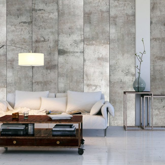 Обои под бетон отлично поддерживают легкую и светлую атмосферу в просторной гостиной