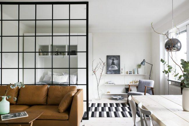 Красивый интерьер спальни-гостиной в скандинавском стиле