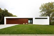 Фото 7 Проект дома с двумя гаражами: выбираем лучшее готовое решение для строительства
