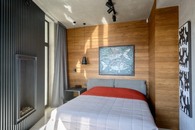 Использование ламината для отделки одной из стен спальни