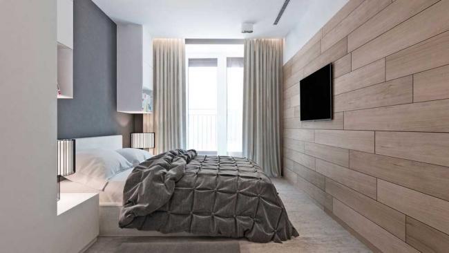 Современная светлая спальня с ламинатом на стене и ковролином на полу